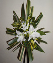 contemporary arranagement with lilies and phormium leaves
