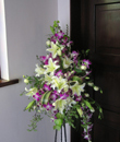 porch pedestal with pink orchids